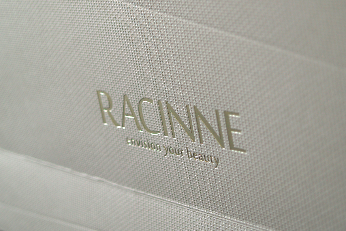 Racinne - bespoke carrier and brochure suite